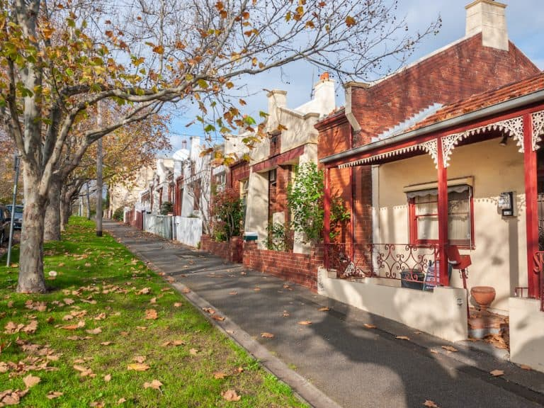 pedestrian sidewalk and victorian style houses in a quiet neighbourhood street view of a melbourne old residential suburb north melbourne vic australia